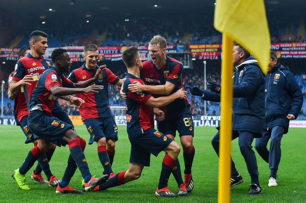 Genoa's Krzysztof Piatek, center, celebrates with his teammates after scoring during the Italian Serie A soccer match between Genoa and Atalanta in Ge...