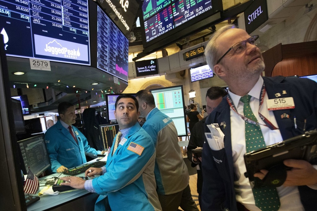 FILE - In this Dec. 11, 2018, file photo, William Geier Jr., left, and David O'Day work at the New York Stock Exchange in New York. No matter which wa