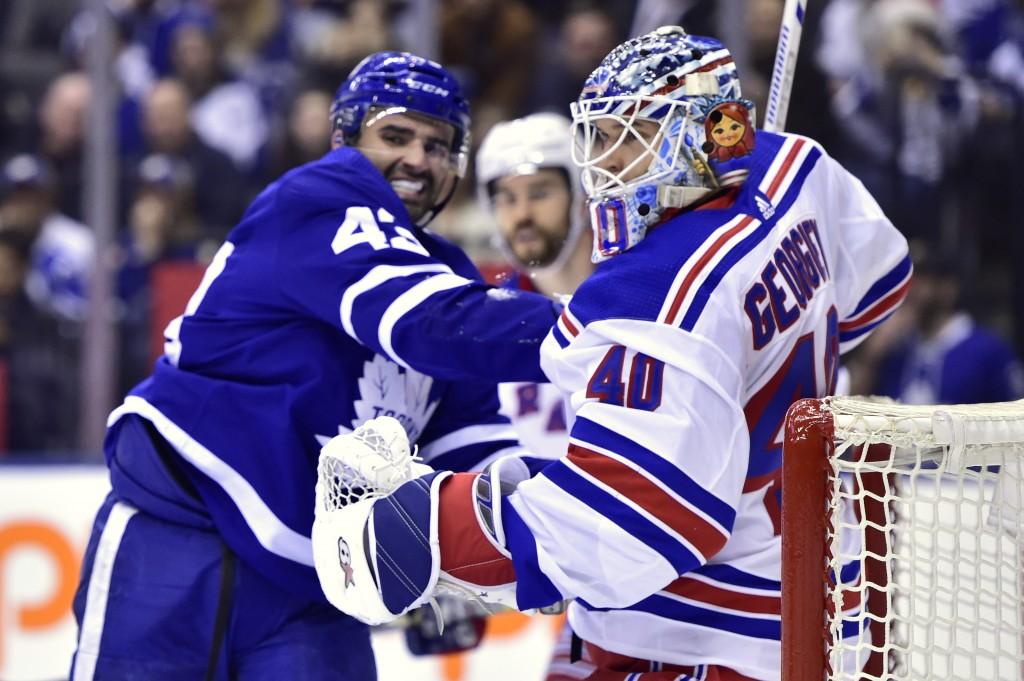 Toronto Maple Leafs center Nazem Kadri (43) and New York Rangers goaltender Alexandar Georgiev (40) work in front of the net during the second period ...