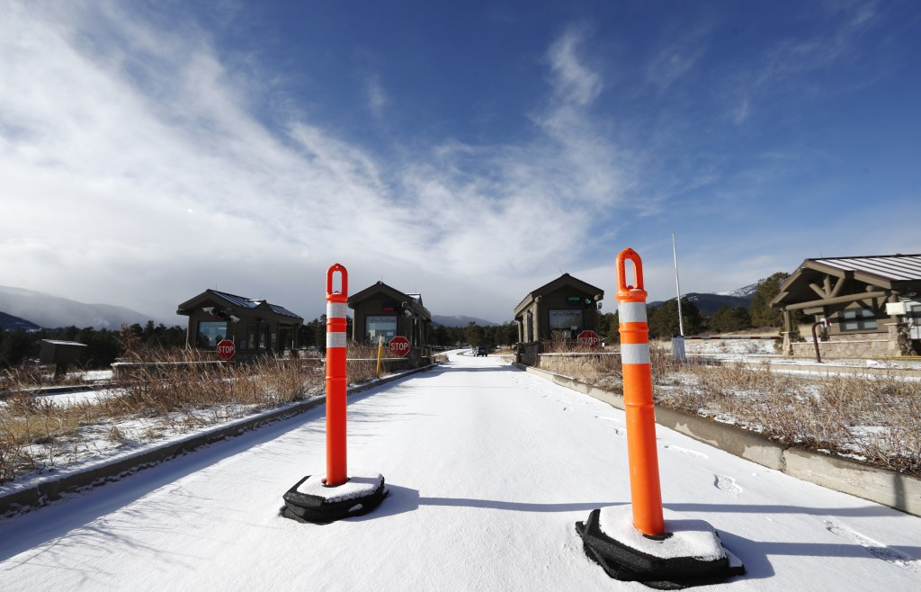 A lane is blocked to an unattended toll booth at Rocky Mountain National Park Saturday, Dec. 22, 2018, in Estes Park, Colo. A partial federal shutdown...