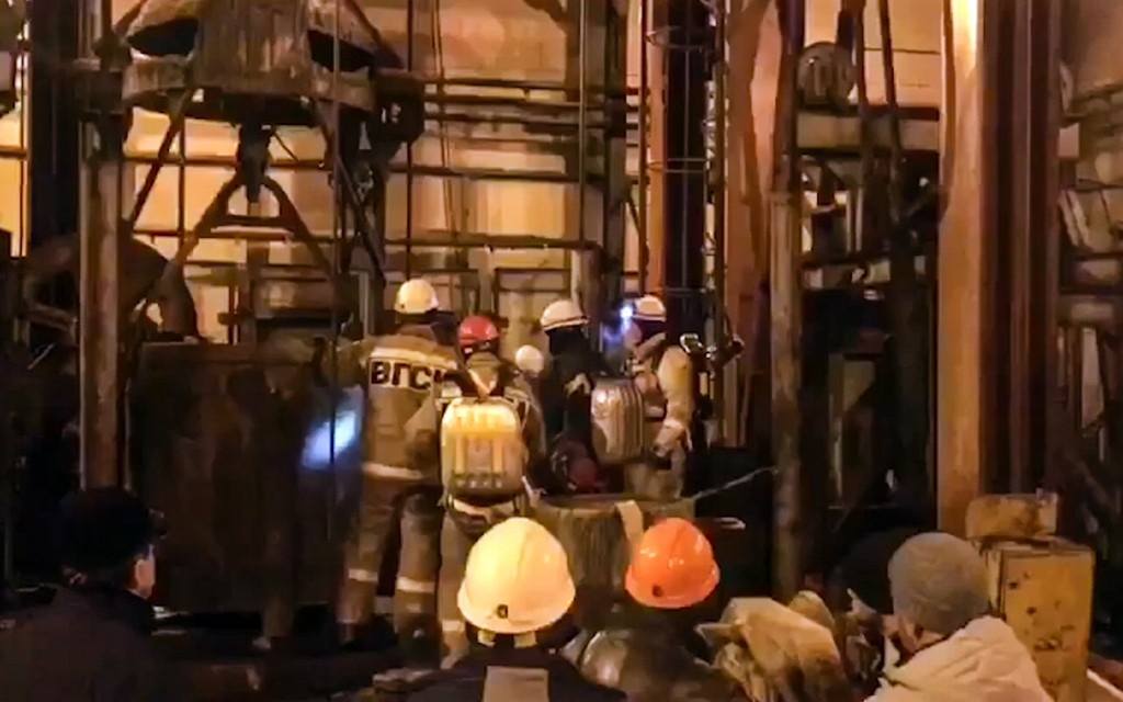 In this video grab provided by RU-RTR Russian television via AP television, Russian rescue team wait for a elevator to go down into the mine potash mi...