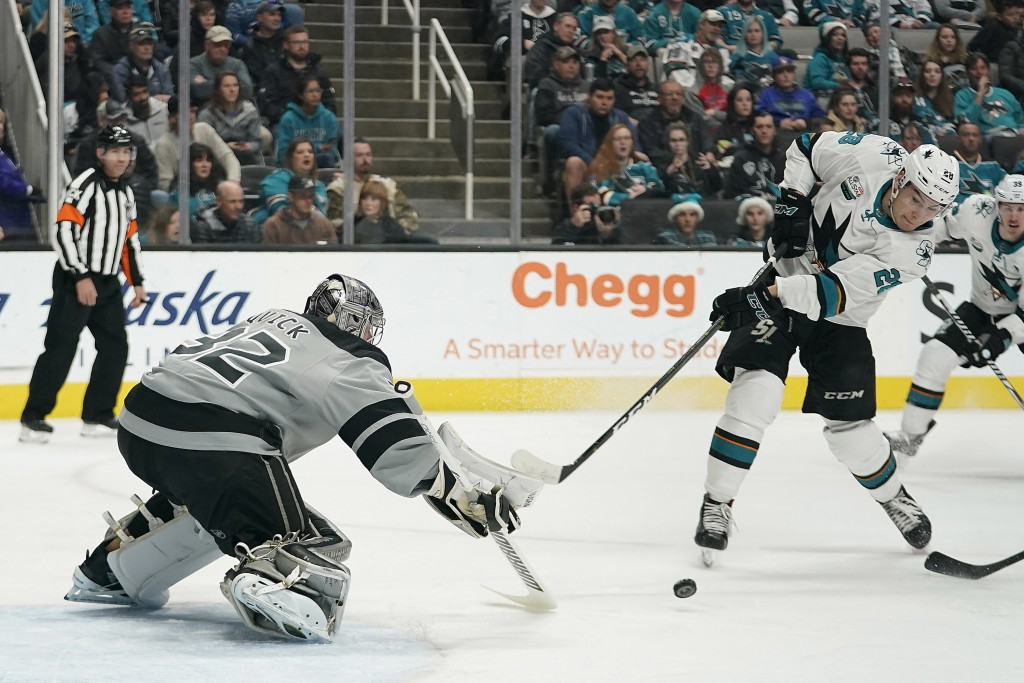 Los Angeles Kings goaltender Jonathan Quick (32) defends on a shot by San Jose Sharks right wing Timo Meier (28) during the first period of an NHL hoc...