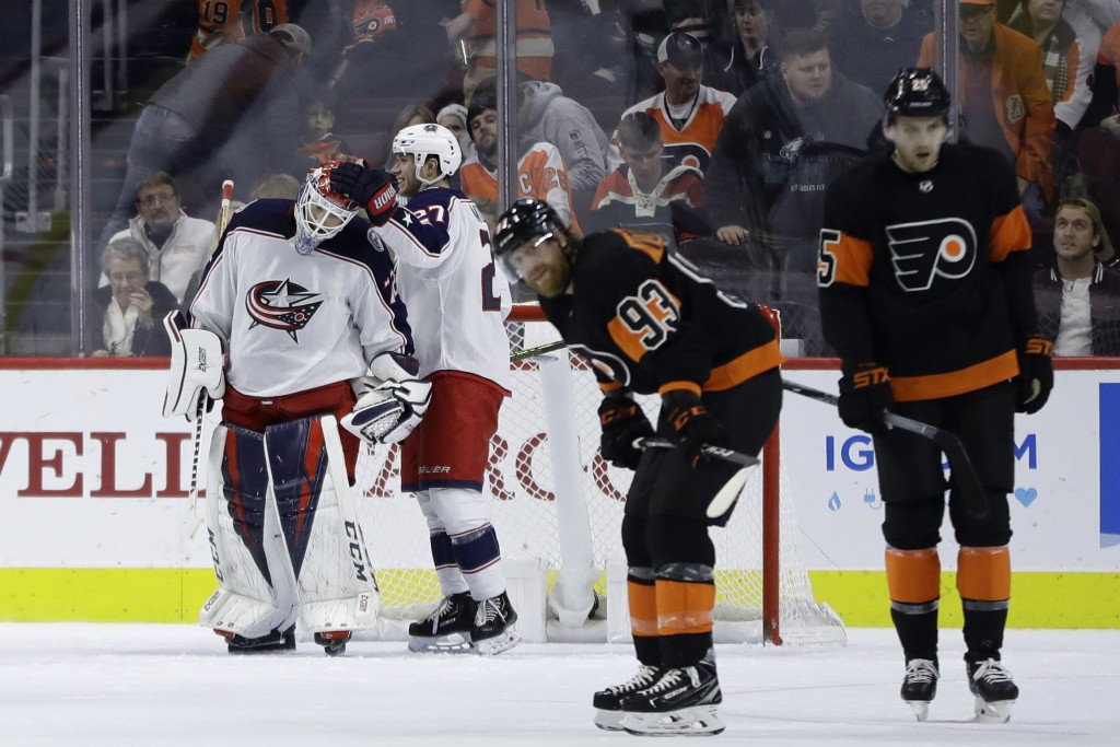 Columbus Blue Jackets' Sergei Bobrovsky, from left, and Ryan Murray (27) celebrate past Philadelphia Flyers' Jakub Voracek (93) and James van Riemsdyk...