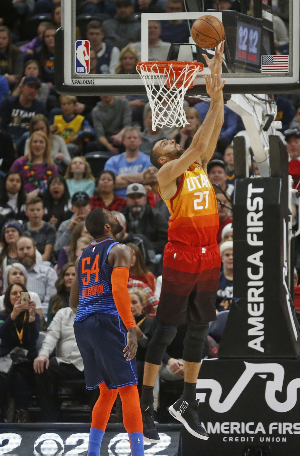 Utah Jazz center Rudy Gobert (27) lays the ball up as Oklahoma City Thunder forward Patrick Patterson (54) looks on in the first half of an NBA basket...