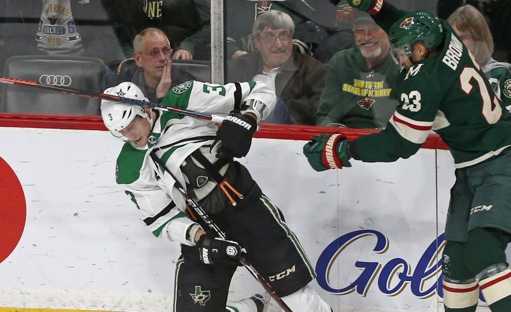 Minnesota Wild's Gustav Olofsson, right, of Sweden, loses his stick to Dallas Stars' John Klingberg, of Sweden, along the boards in the first period o...