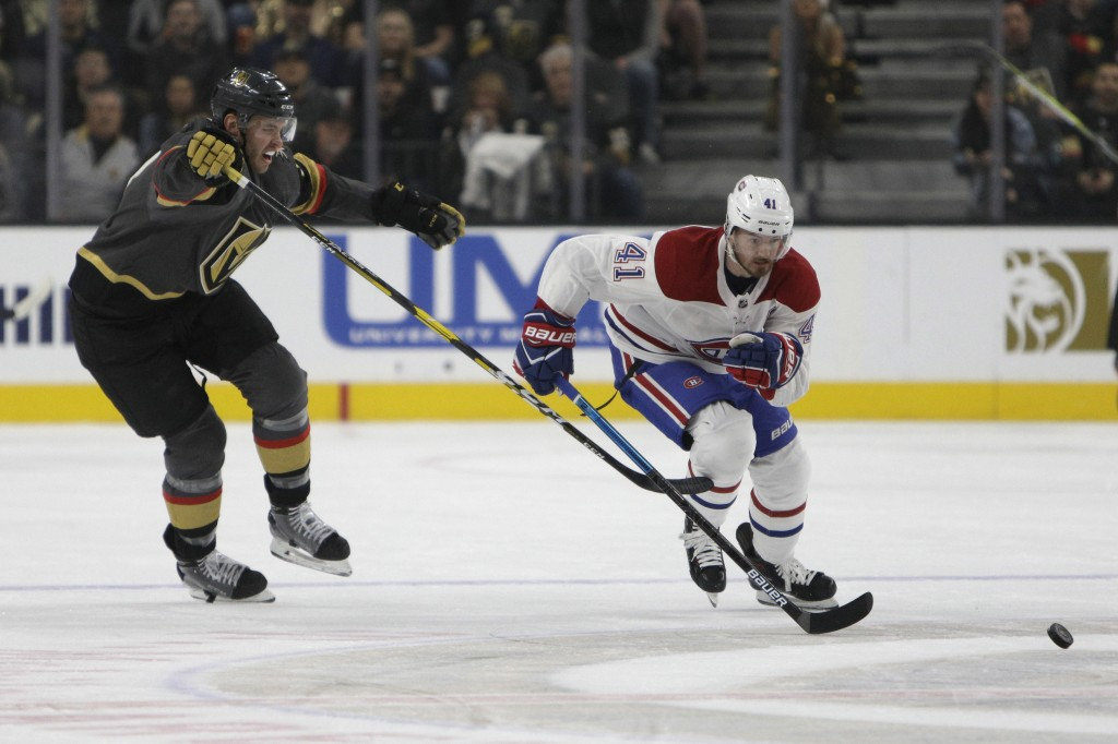 Montreal Canadiens left wing Paul Byron (41) goes for the puck during the first period of an NHL hockey game against the Vegas Golden Knights Saturday...