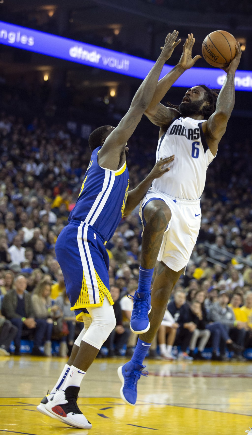 Dallas Mavericks' DeAndre Jordan (6) shoots over Golden State Warriors' Draymond Green during the second quarter of an NBA basketball game Saturday, D...
