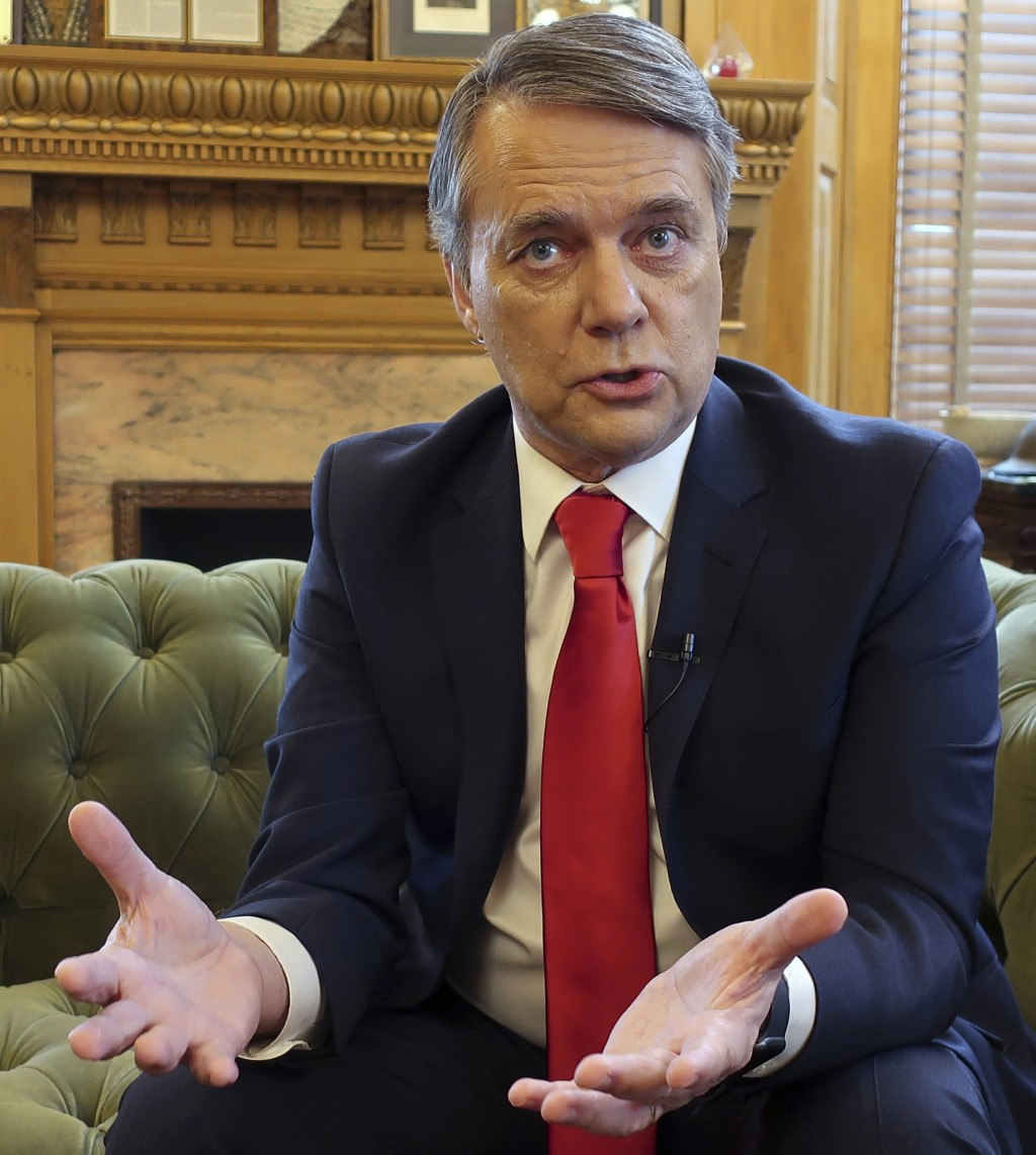 In this photo taken Dec. 20, 2018, departing Kansas Gov. Jeff Colyer responds to questions from The Associated Press during an interview in his office