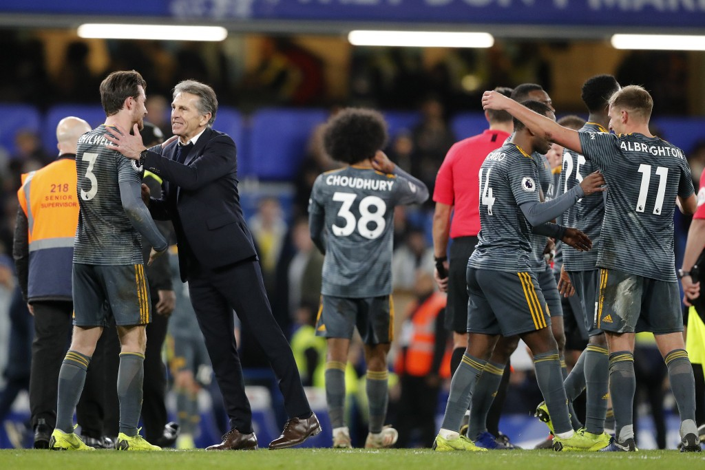 Leicester's team manager Claude Puel, 2nd from left, congratulates Leicester's Ben Chilwell celebrating after they won the English Premier League socc...