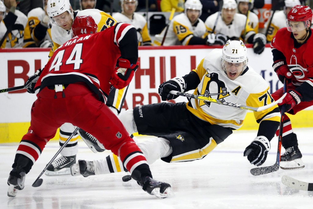 Pittsburgh Penguins' Evgeni Malkin (71) goes to the ice after colliding with Carolina Hurricanes' Calvin de Haan (44) during the second period of an N...