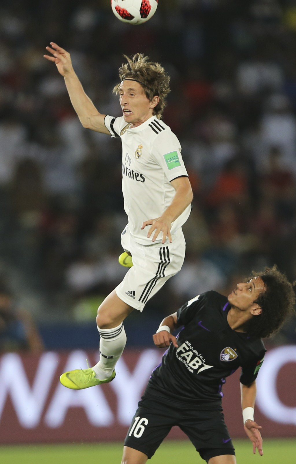 Real Madrid's Luka Modric heads the ball above Emirates's Al Ain Mohamed Abdulrahman during the Club World Cup final soccer match between Real Madrid ...