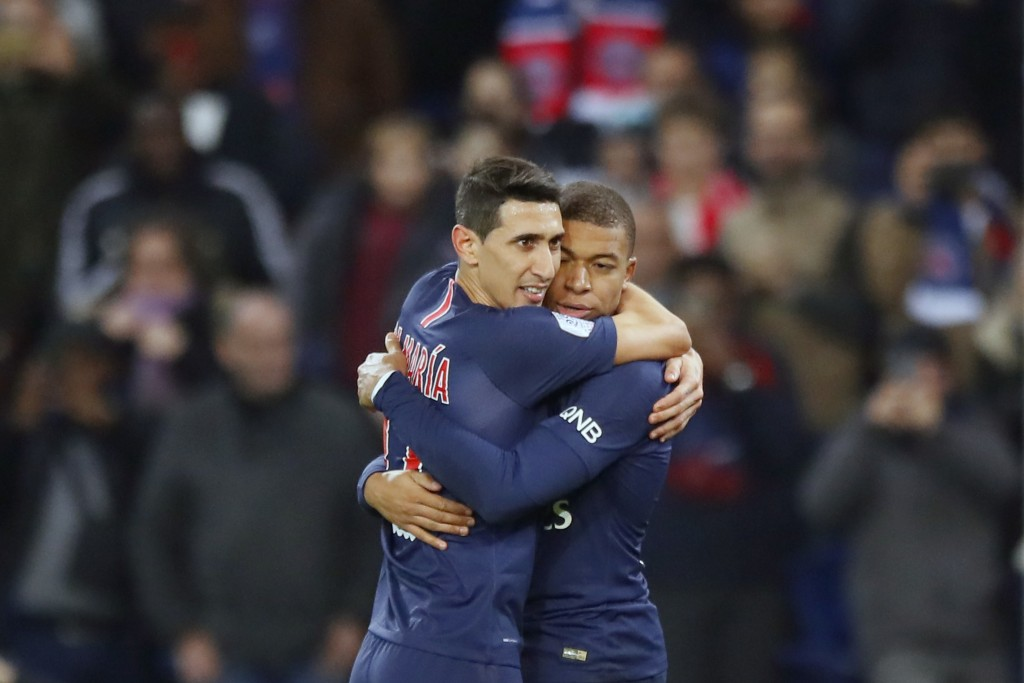 PSG forward Angel Di Maria, left, greets PSG forward Kylian Mbappe after scoring his side first goal during the League One soccer match between Paris ...
