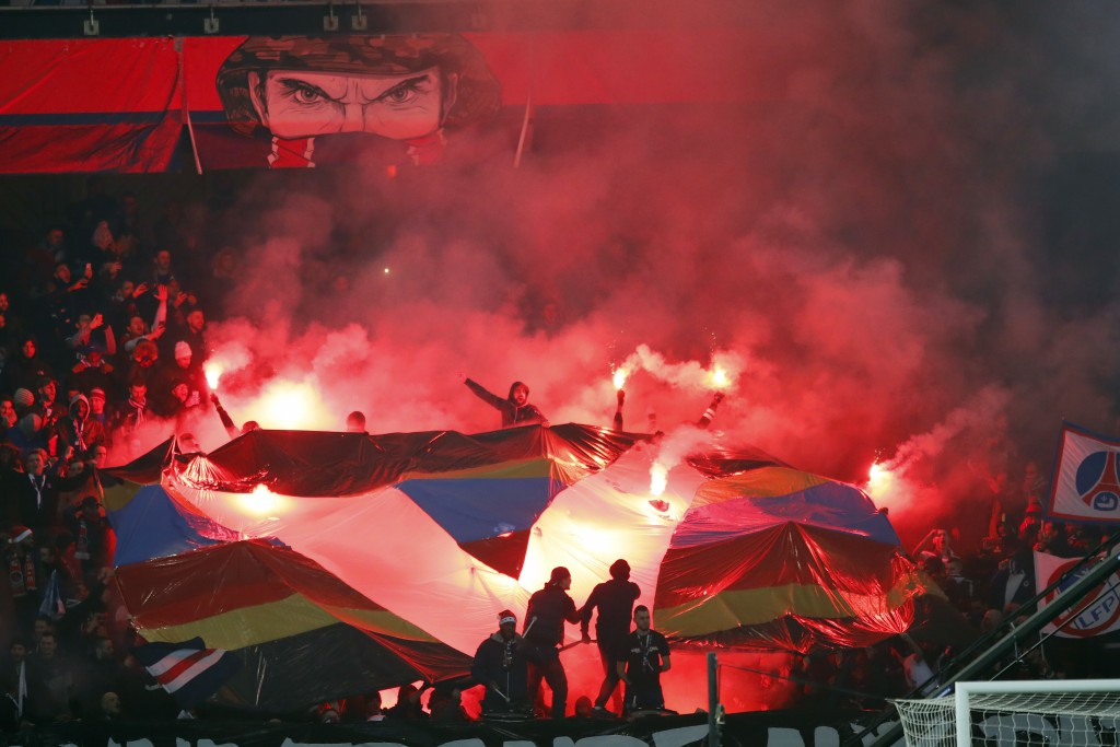 Paris Saint Germain's fans reacts with flares during the League One soccer match between and Nantes at the Parc des Princes stadium in Paris, Saturday