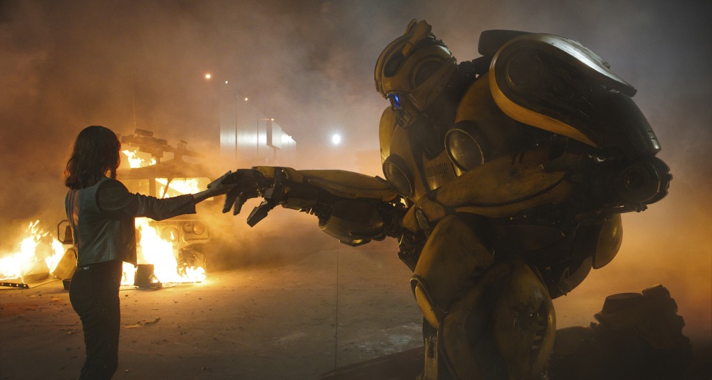 "This image released by Paramount Pictures shows Hailee Steinfeld as Charlie and Bumblebee in a scene from ""Bumblebee."" (Paramount Pictures via AP)"