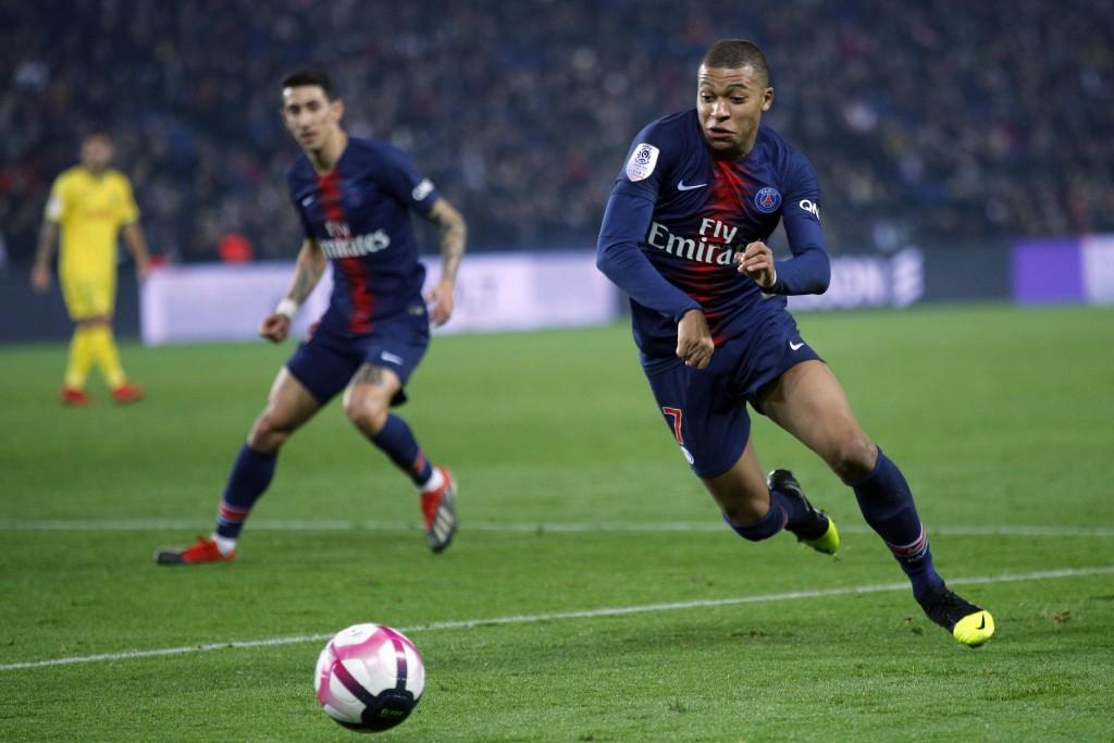 Paris St Germain's Kylian Mbappe runs for the ball during the League One soccer match between Paris Saint Germain and Nantes at the Parc des Princes s...