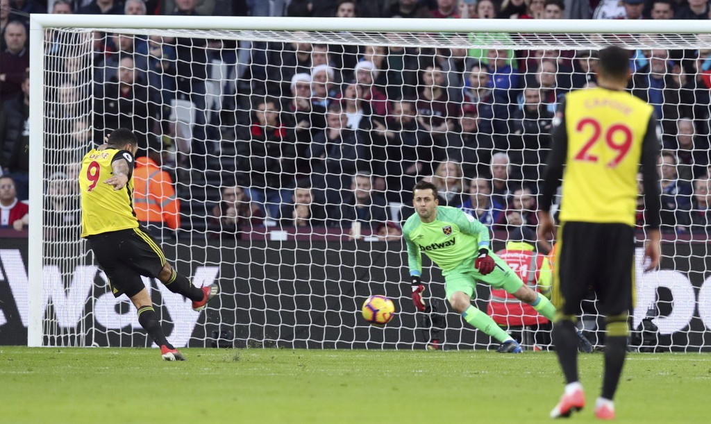 Watford's Troy Deeney scores his side's first goal of the game from the penalty spot during their English Premier League soccer match against West Ham