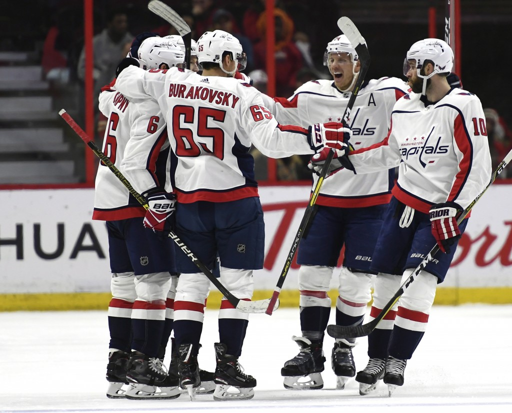 Washington Capitals players celebrate the goal of defenseman Michal Kempny (6) against the Ottawa Senators during the second period of an NHL hockey g...