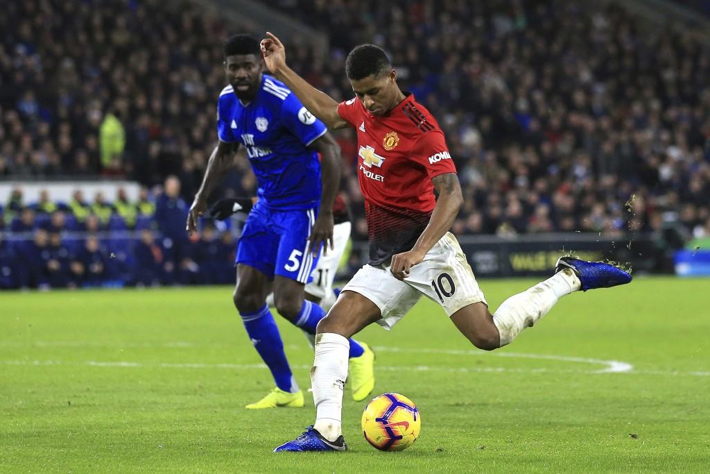 Manchester United forward Marcus Rashford, right, controls the ball by Cardiff City defender Bruno Ecuele Manga during the English Premier League matc...