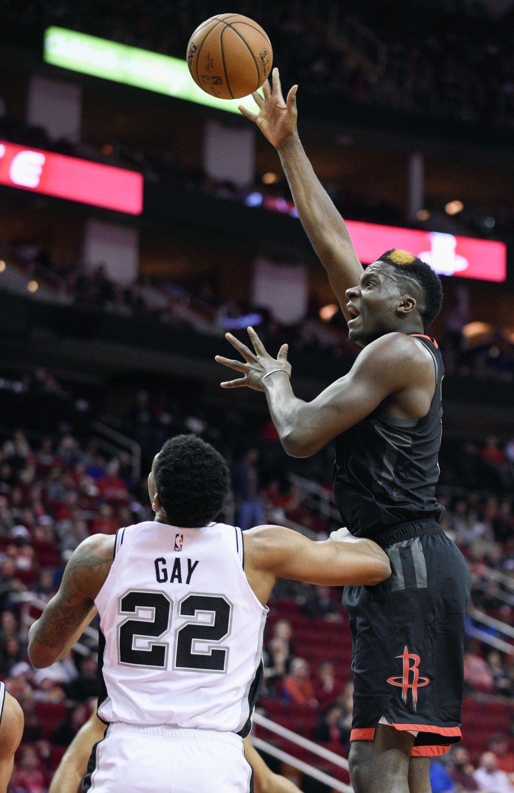 Houston Rockets center Clint Capela, right, shoots over San Antonio Spurs forward Rudy Gay during the first half of an NBA basketball game, Saturday, ...