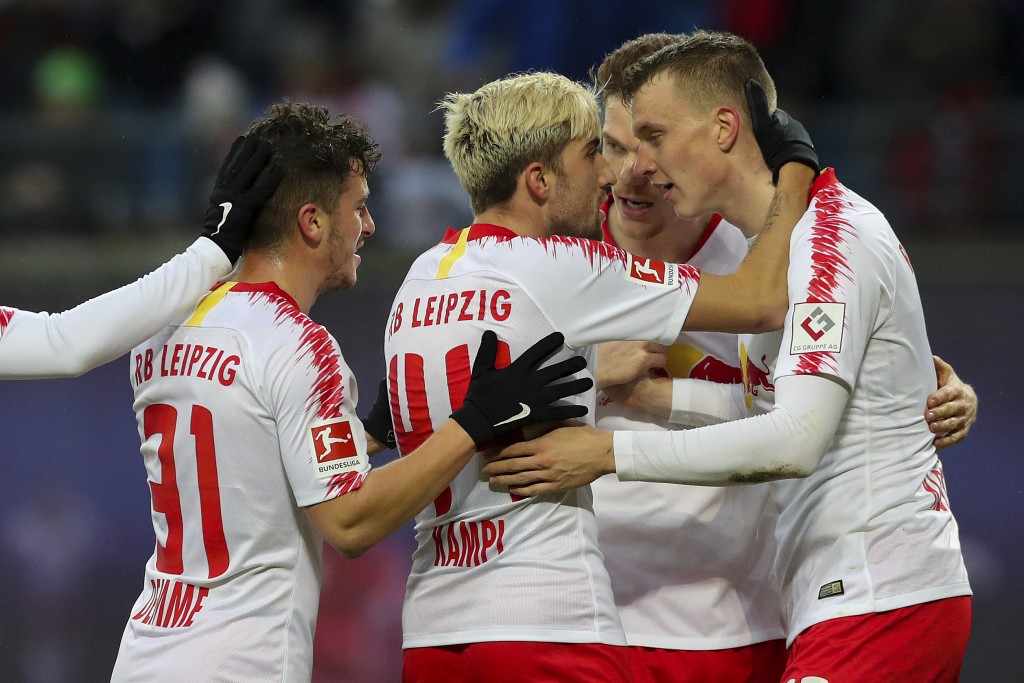 Leipzig's scorer Lukas Klostermann, right, and his teammates celebrate the opening goal during the German Bundesliga soccer match between RB Leipzig a