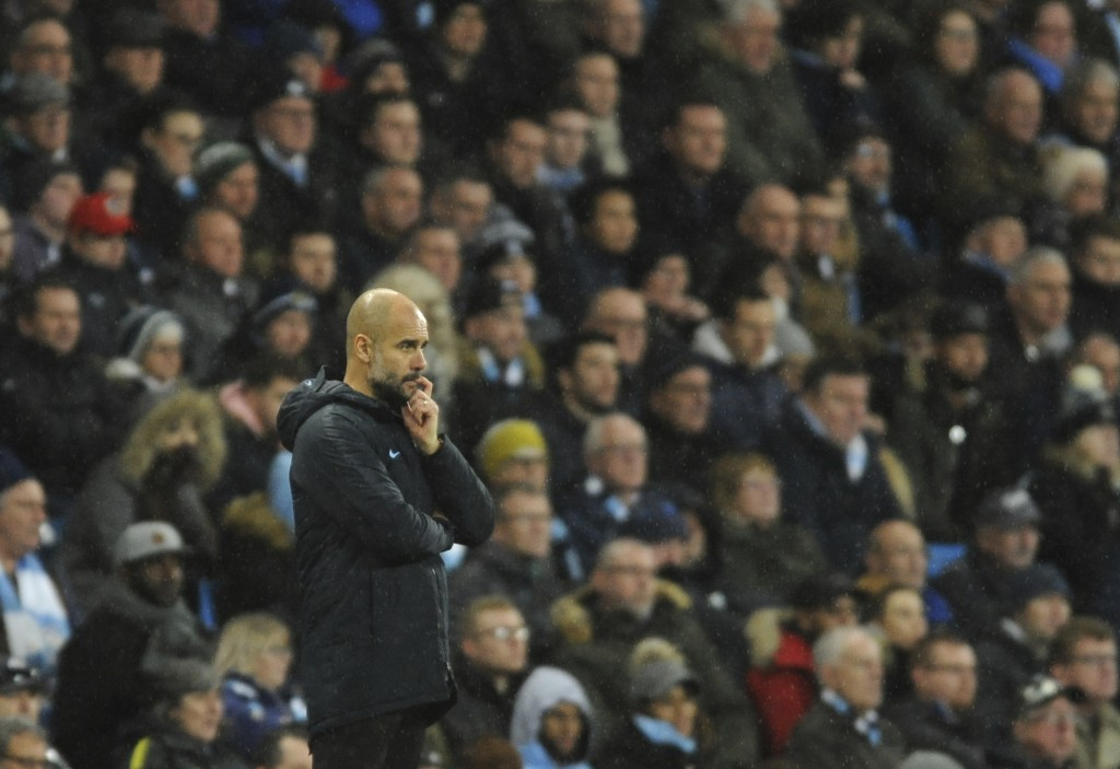 Manchester City manager Josep Guardiola follows the game during the English Premier League soccer match between Manchester City and Crystal Palace at ...