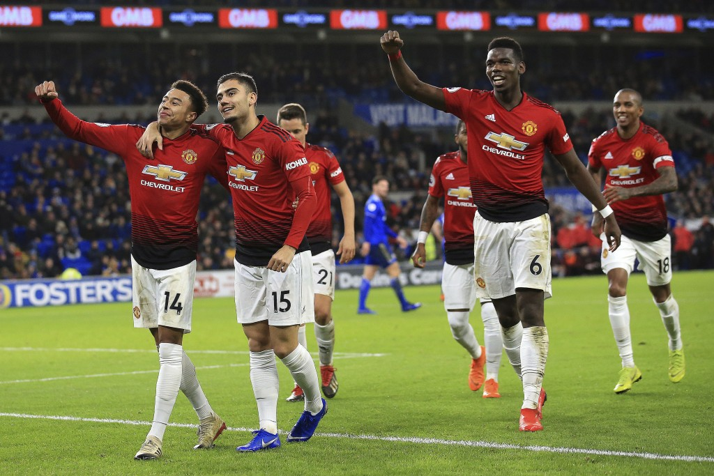 Manchester United midfielder Jesse Lingard, left, celebrates his goal against Cardiff City during the English Premier League match between Cardiff Cit...