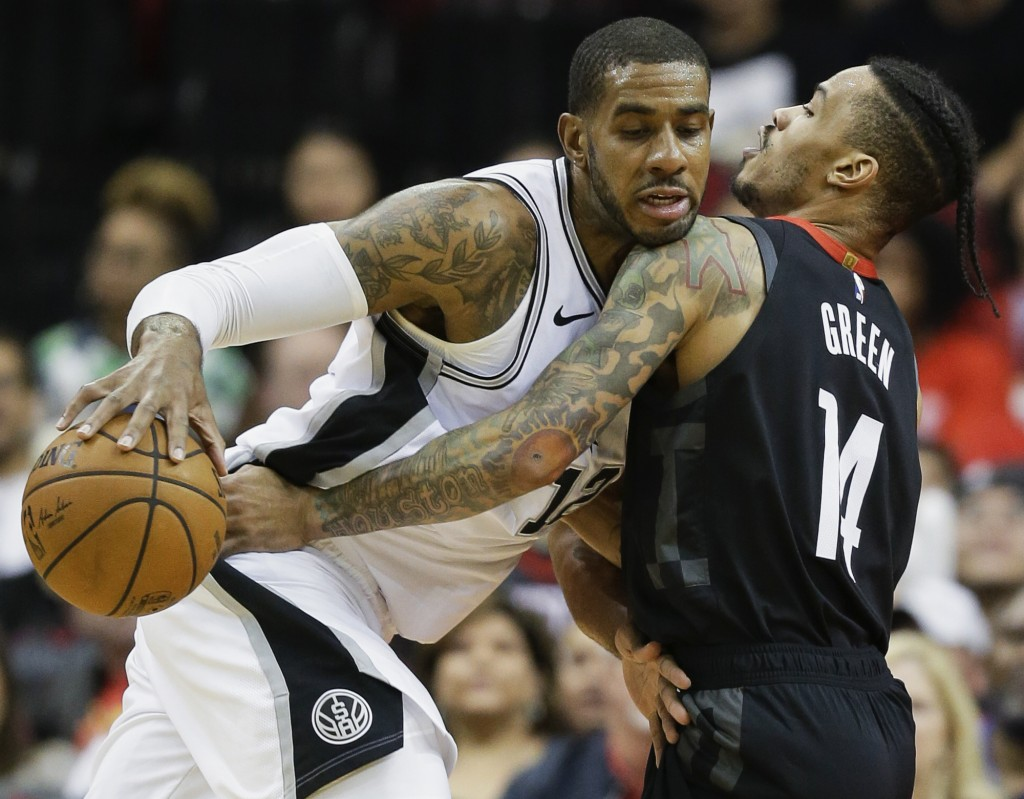 San Antonio Spurs forward LaMarcus Aldridge, left, dribbles as Houston Rockets guard Gerald Green defends during the first half of an NBA basketball g...