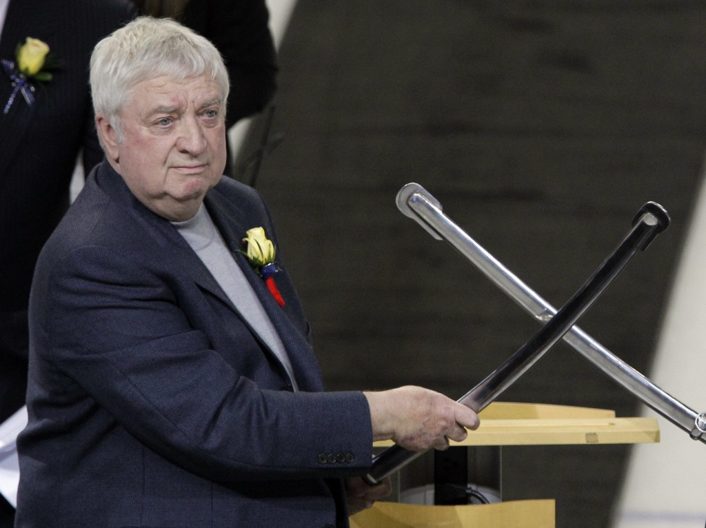 FILE - In this Tuesday, Nov. 8, 2011, file photo, Buffalo Sabres Hall of Fame Class of 2012 inductee Rick Jeanneret helps salute the crowd with fellow...
