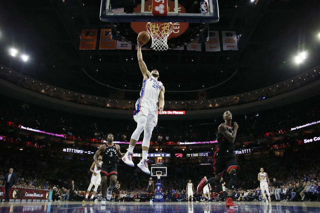 Philadelphia 76ers' Ben Simmons goes up for a dunk during the first half of an NBA basketball game against the Toronto Raptors, Saturday, Dec. 22, 201...