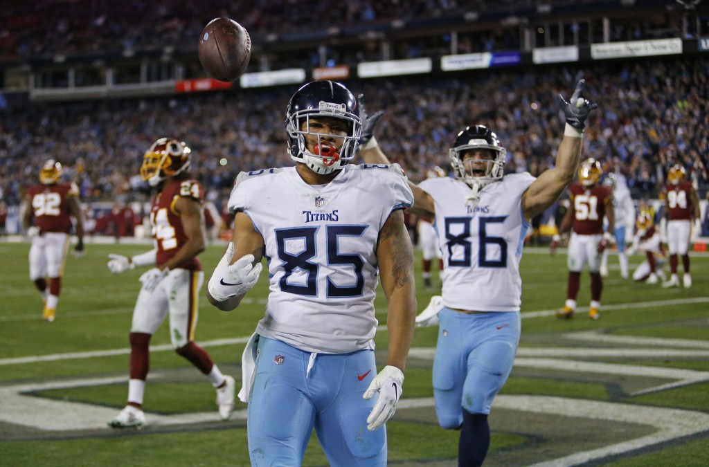 Tennessee Titans tight end MyCole Pruitt (85) flips the ball over his shoulder after he scored a touchdown on a 2-yard pass reception against the Wash...