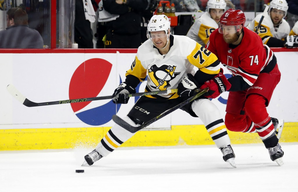 Pittsburgh Penguins' Patric Hornqvist (72) is pestered by Carolina Hurricanes' Jaccob Slavin (74) during the second period of an NHL hockey game, Satu...