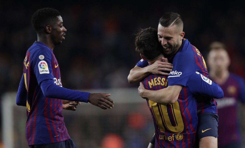 FC Barcelona's Lionel Messi celebrates after scoring with his teammate Jordi Alba during the Spanish La Liga soccer match between FC Barcelona and Cel...