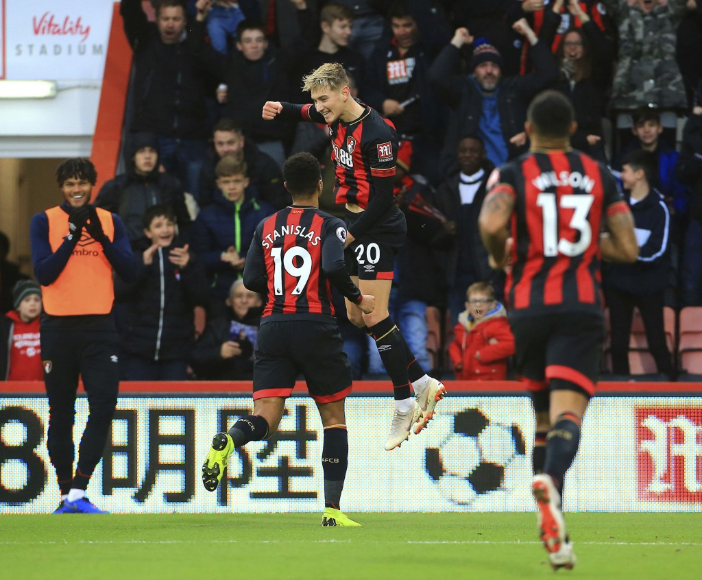 Bournemouth's David Brooks, centre, celebrates scoring his side's first goal of the game with team mates during the English Premier League soccer matc...