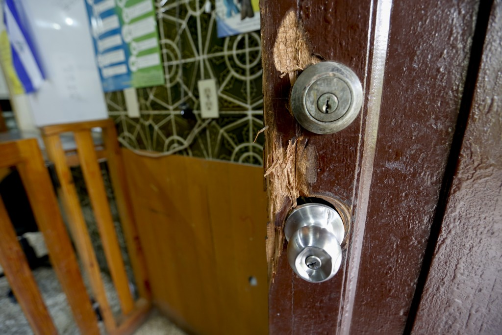 This Dec. 14, 2018 photo shows a door damaged by police when they forced their way into the offices of the Popol Na Foundation, in Managua, Nicaragua.