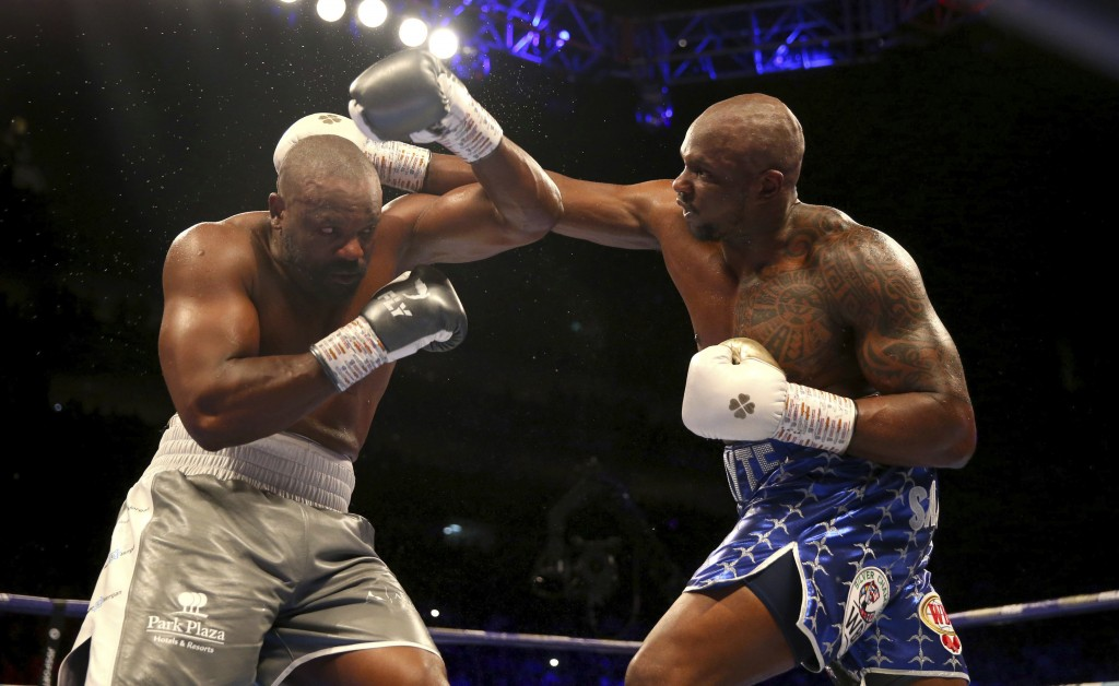 Dillian Whyte, right, tries to hit Dereck Chisora during a heavyweight boxing bout Saturday, Dec. 22, 2018, in London. (Steven Paston/PA via AP)
