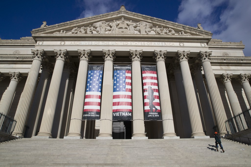 People walk up the steps even though the National Archives is closed with the partial government shutdown, Saturday, Dec. 22, 2018 in Washington. (AP ...