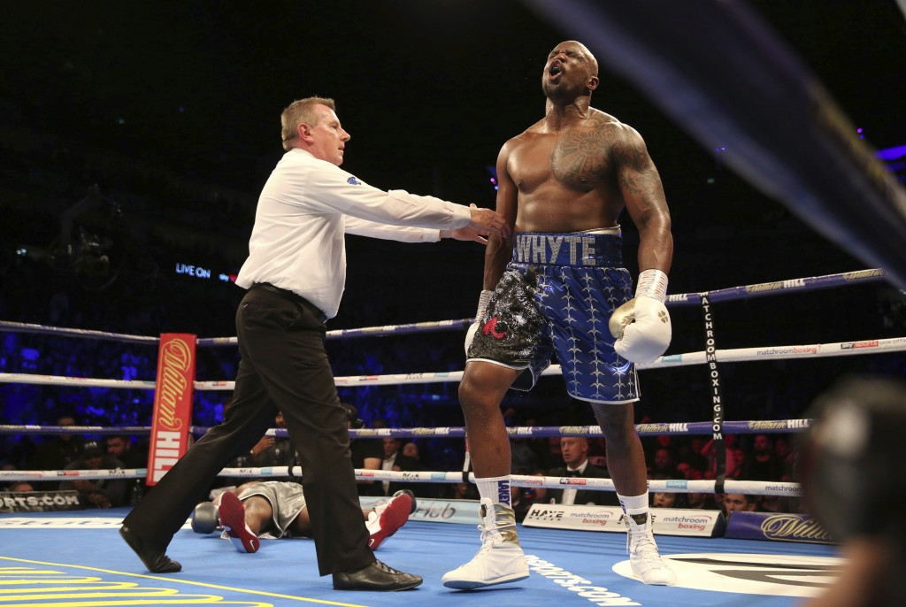 Dillian Whyte celebrates after knocking out Dereck Chisora during a heavyweight boxing bout Saturday, Dec. 22, 2018, in London. (Steven Paston/PA via ...