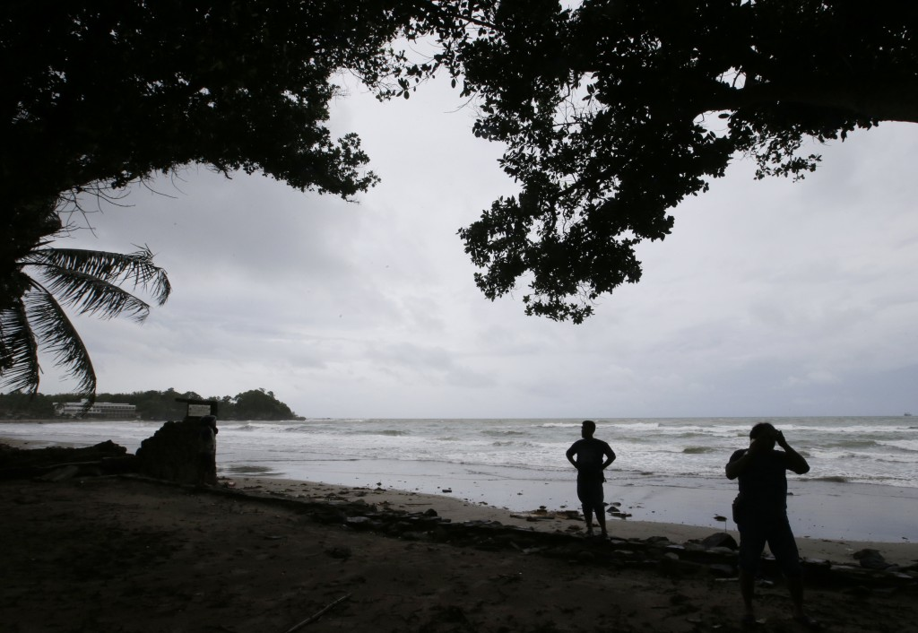 Indonesian rescuers search for the bodies of tsunami victims in Carita, Indonesia, Sunday, Dec. 23, 2018. The tsunami occurred after the eruption of a