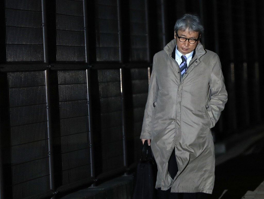 FILE - In this Thursday, Dec. 20, 2018, file photo, Motonari Otsuru, defense lawyer of former Nissan chairman Carlos Ghosn, leaves Tokyo Detention Cen...