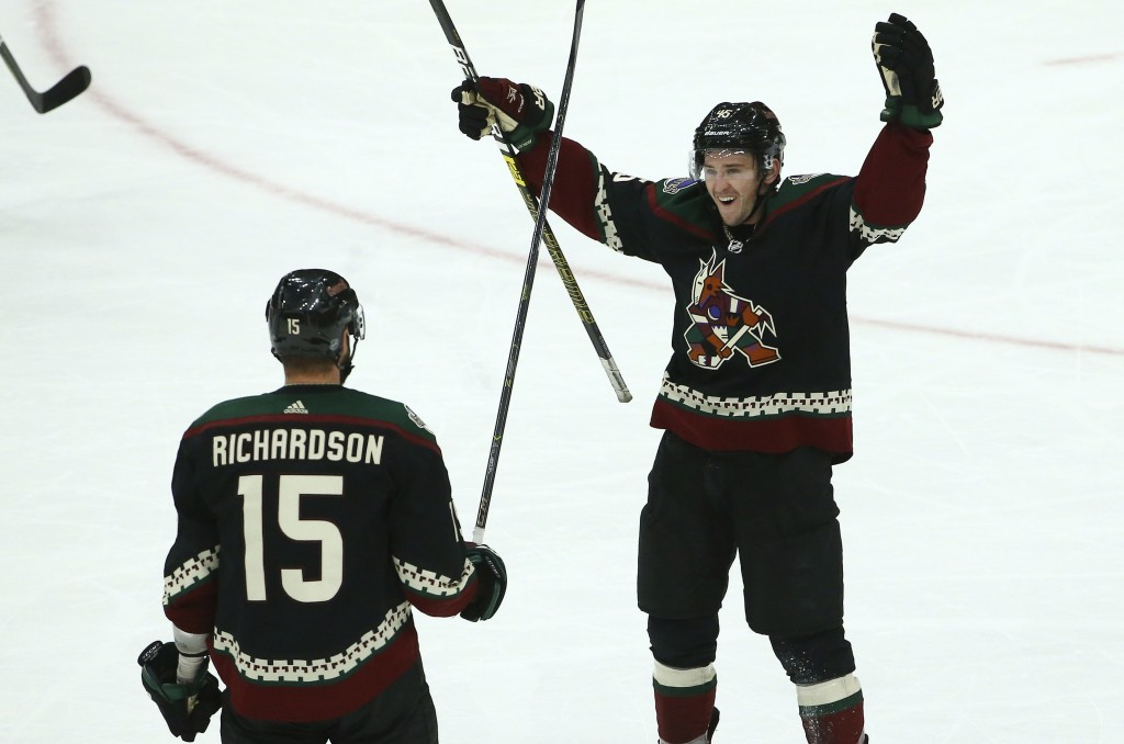 Arizona Coyotes center Brad Richardson (15) celebrates his goal against the Colorado Avalanche with Coyotes right wing Josh Archibald (45) during the ...