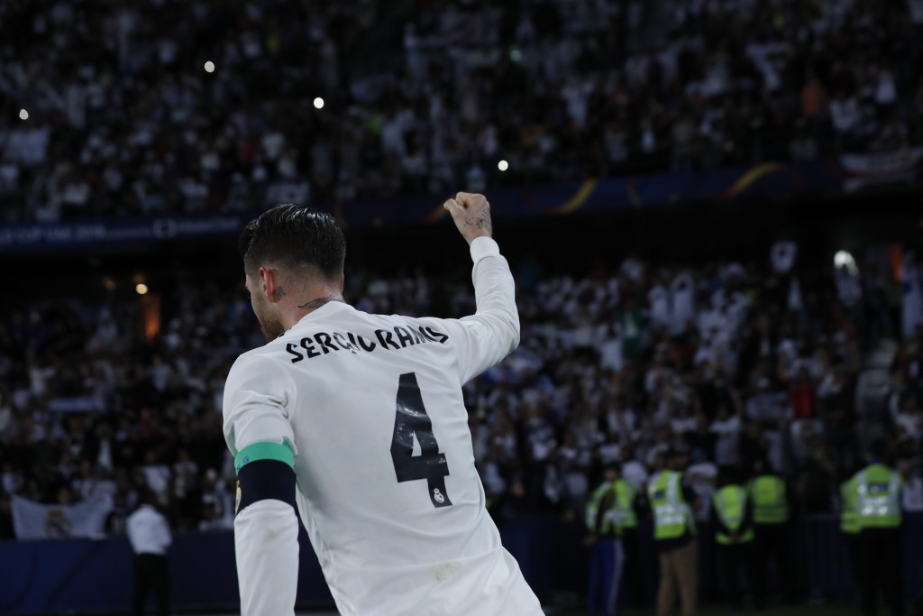 Real Madrid's defender Sergio Ramos celebrates after scoring during the Club World Cup final soccer match between Real Madrid and Al Ain at Zayed Spor...