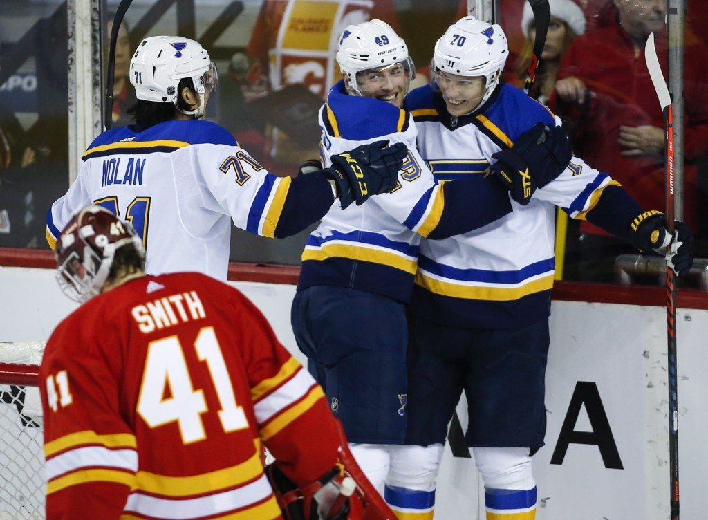 St. Louis Blues' Oskar Sundqvist, right, of Sweden, celebrates his goal with teammates Ivan Barbashev, center, of Russia, and Jordan Nolan, left, as C
