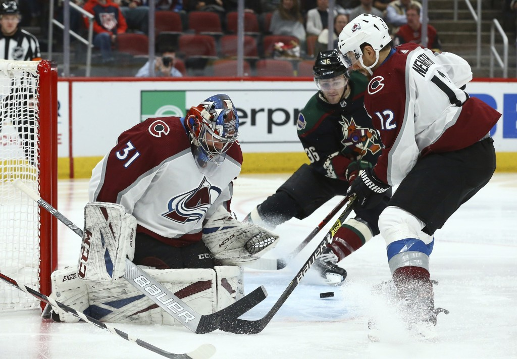 Arizona Coyotes right wing Christian Fischer (36) gets ready to send the puck past Colorado Avalanche goaltender Philipp Grubauer (31) for a goal as A...