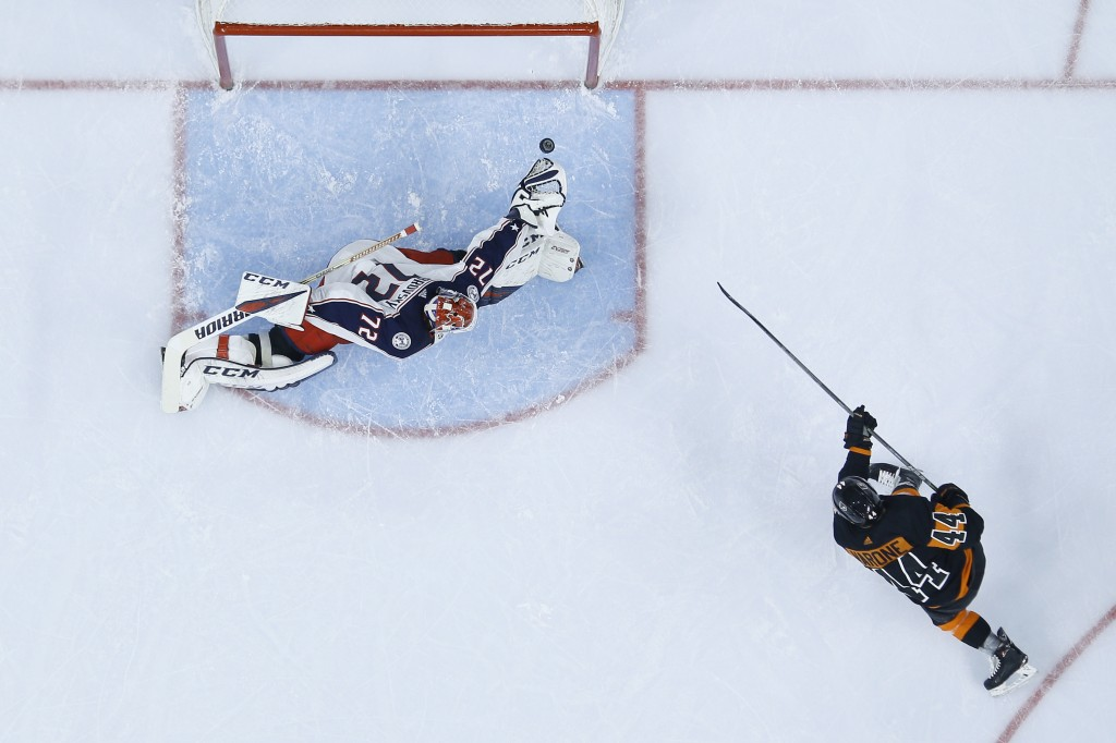 Philadelphia Flyers' Phil Varone (44) scores a goal past Columbus Blue Jackets' Sergei Bobrovsky (72) during the second period of an NHL hockey game, ...