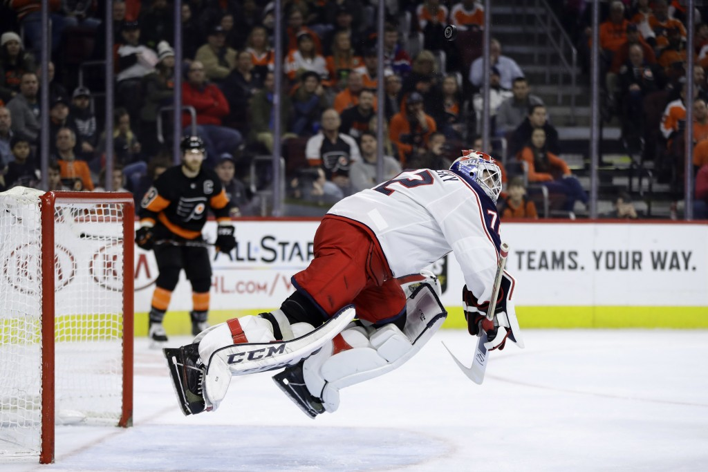 Columbus Blue Jackets' Sergei Bobrovsky lunges to block a shot during the second period of an NHL hockey game against the Philadelphia Flyers, Saturda...
