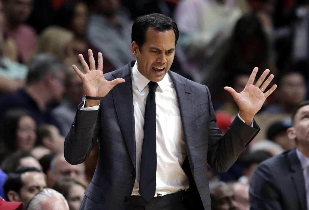 Miami Heat head coach Erik Spoelstra reacts after foul is called during the first half of an NBA basketball game against the Miami Heat, Saturday, Dec...