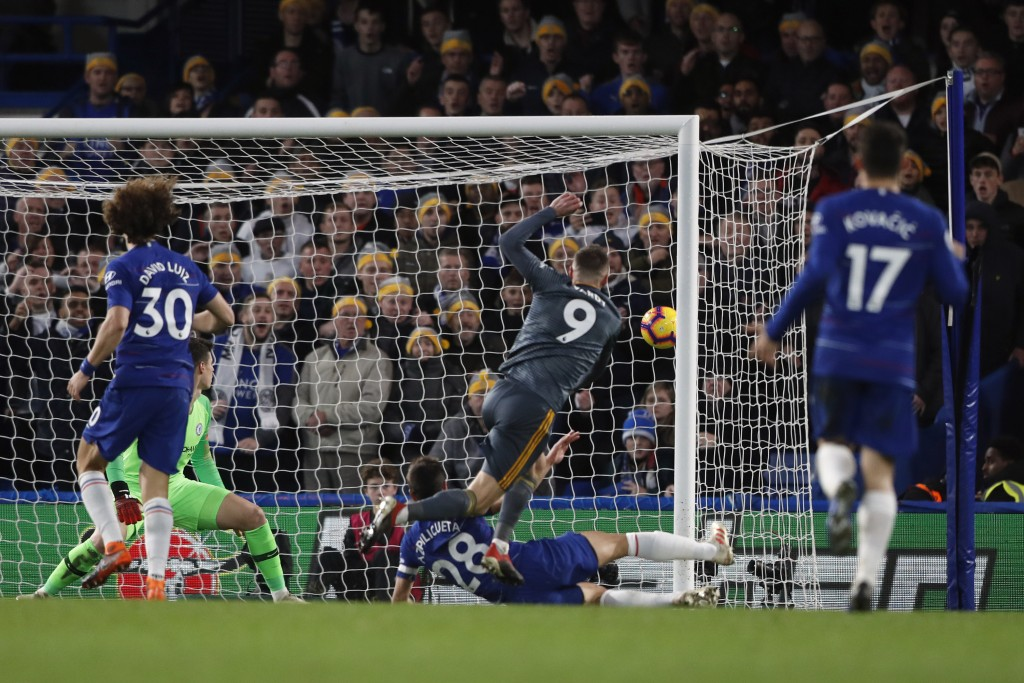 Leicester's Jamie Vardy scores his side opening goal during the English Premier League soccer match between Chelsea and Leicester City at Stamford Bri...