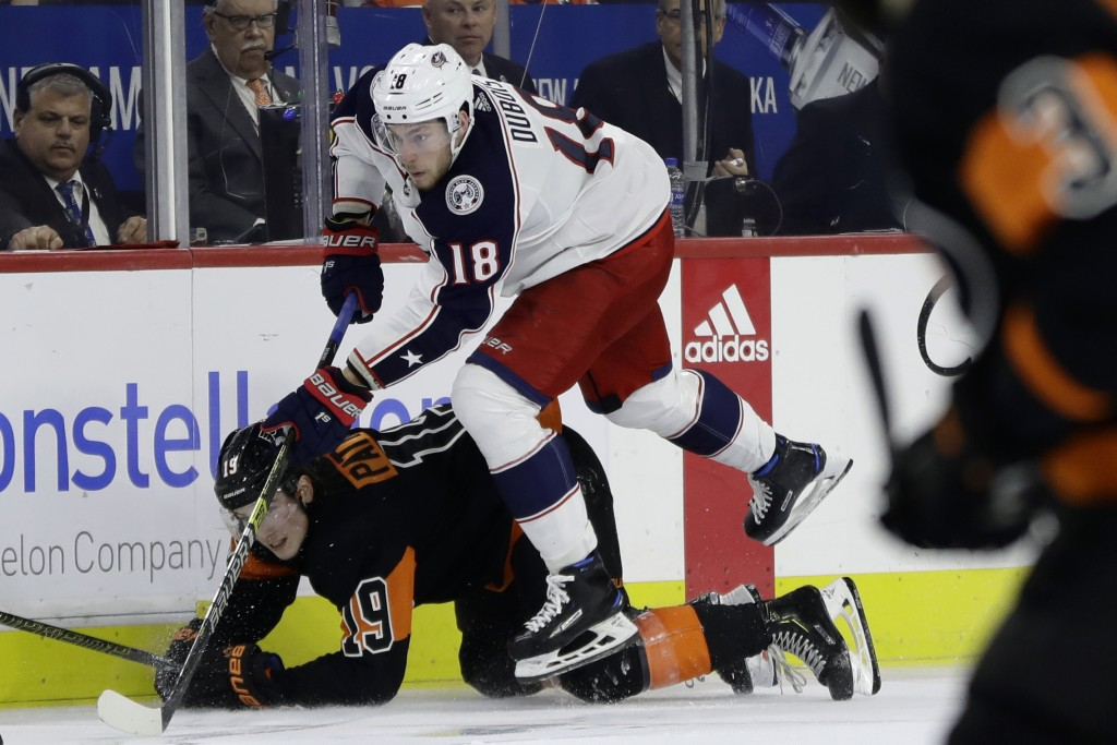 Columbus Blue Jackets' Pierre-Luc Dubois (18) leaps over Philadelphia Flyers' Nolan Patrick (19) during the third period of an NHL hockey game, Saturd...