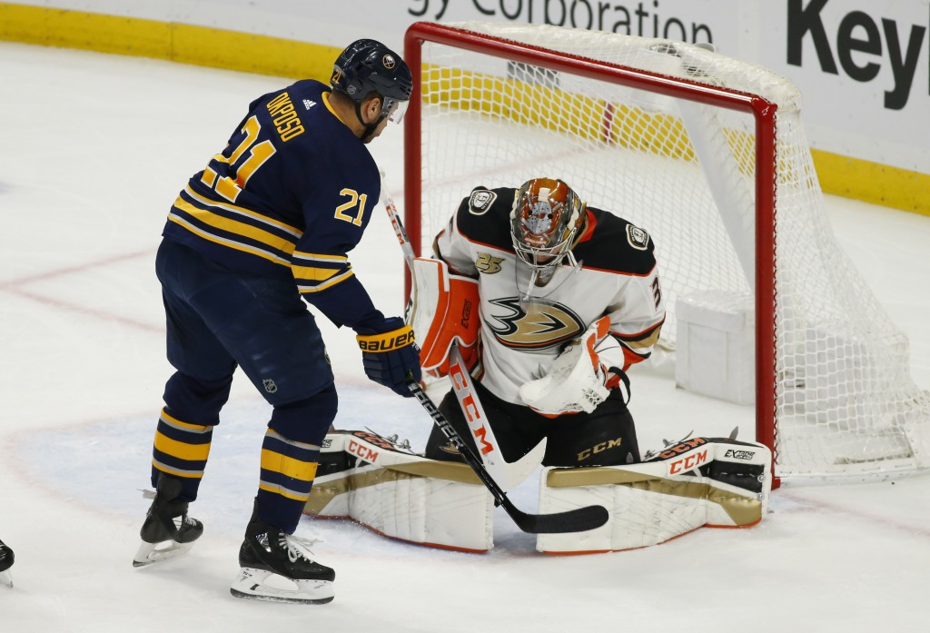 Buffalo Sabres forward Kyle Okposo (21) is stopped by Anaheim Ducks goalie John Gibson (36) during the first period of an NHL hockey game, Saturday, D...