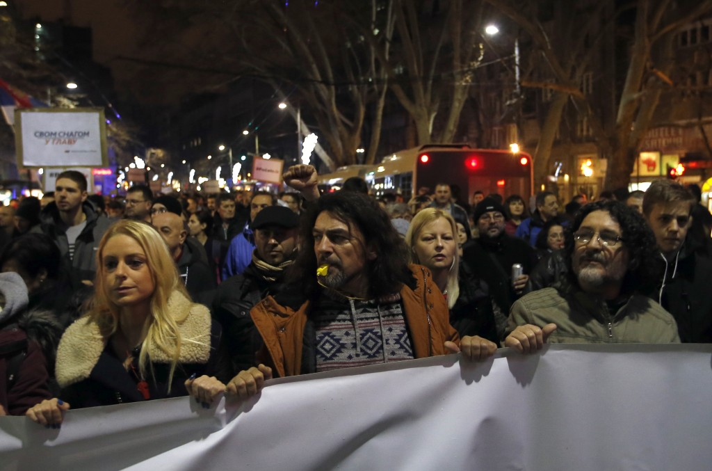 People march during a protest against populist President Aleksandar Vucic in Belgrade, Serbia, Saturday, Dec. 22, 2018. Thousands of people have ralli